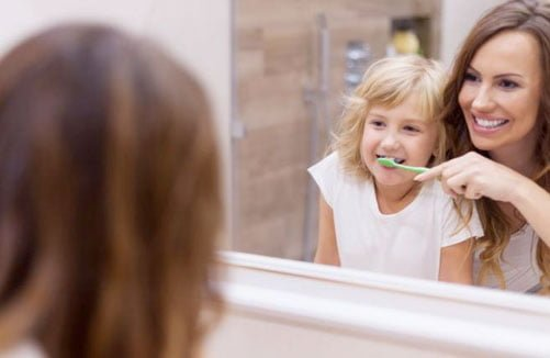 Brushing child's teeth