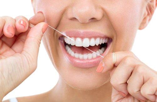 Flossing oral hygiene