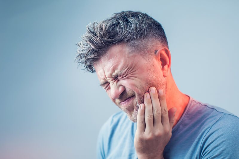 man suffering toothache