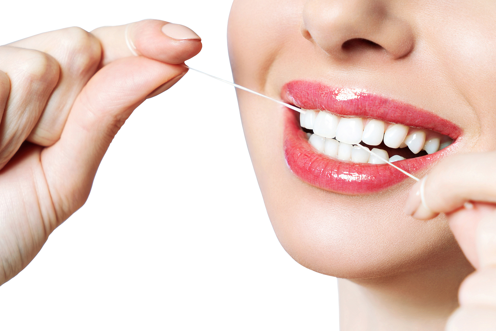 Young beautiful woman is engaged in cleaning teeth. Beautiful smile healthy white teeth.